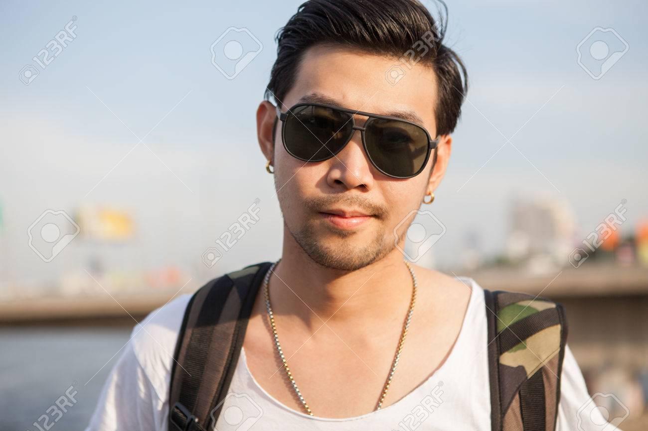 portrait close up head shot of handsome asian man - 52147593