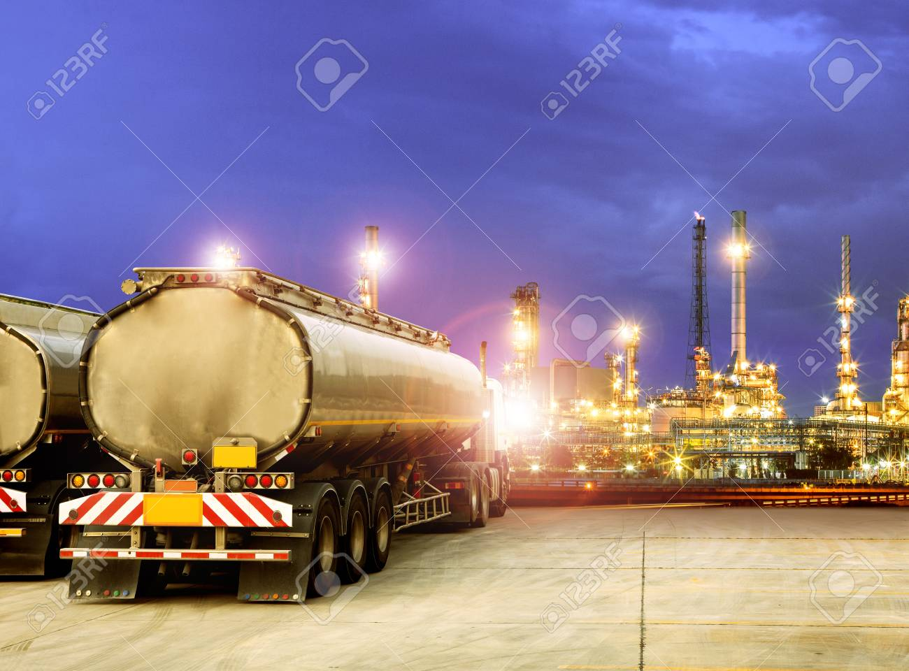 oil container truck and beautiful lighting of oil refinery plant - 99270278