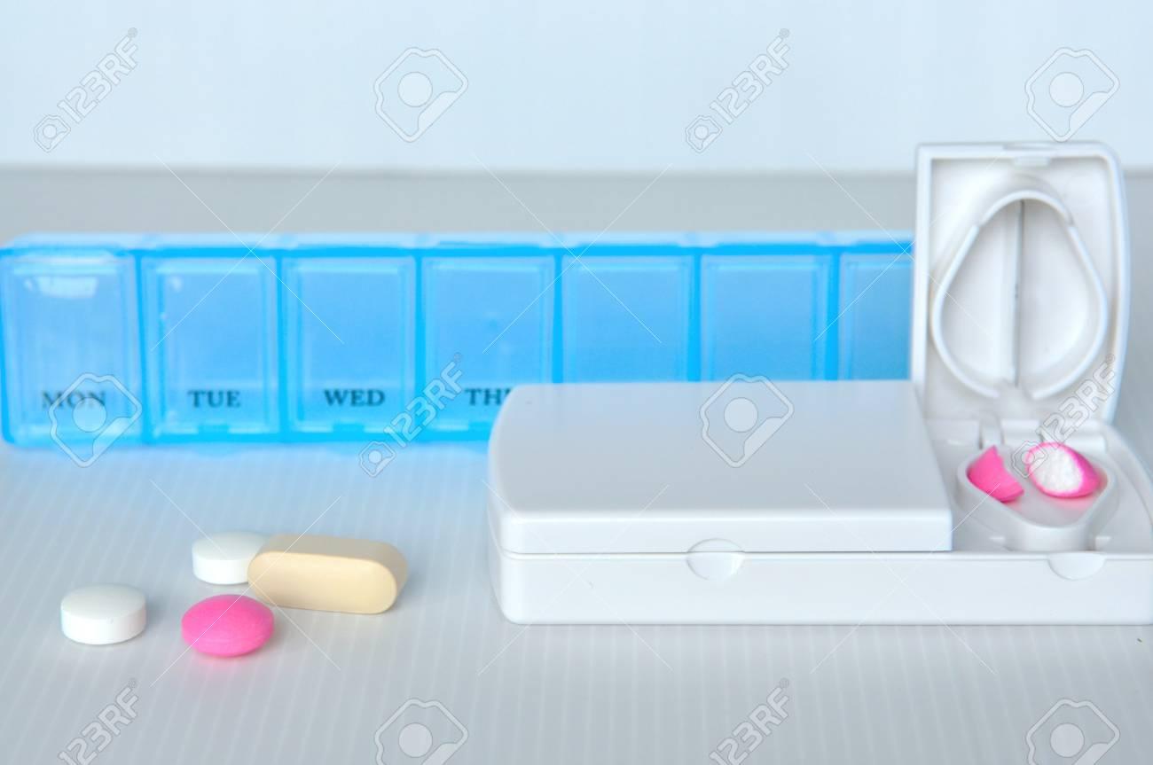 Pill box and split blade show medicine concept Stock Photo - 17593097