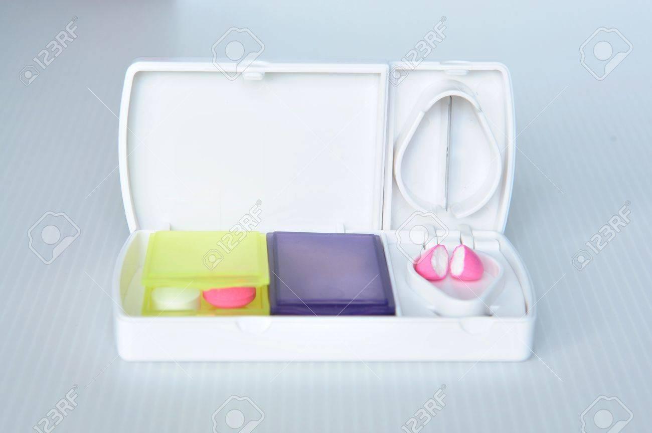 Pill box and split blade show medicine concept Stock Photo - 17592985