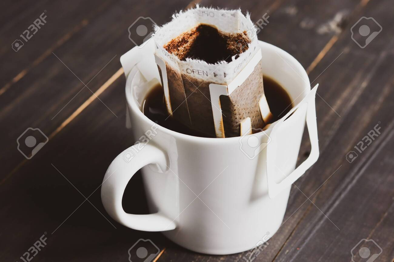 Drip or brewed coffee on old wooden table - 140286677