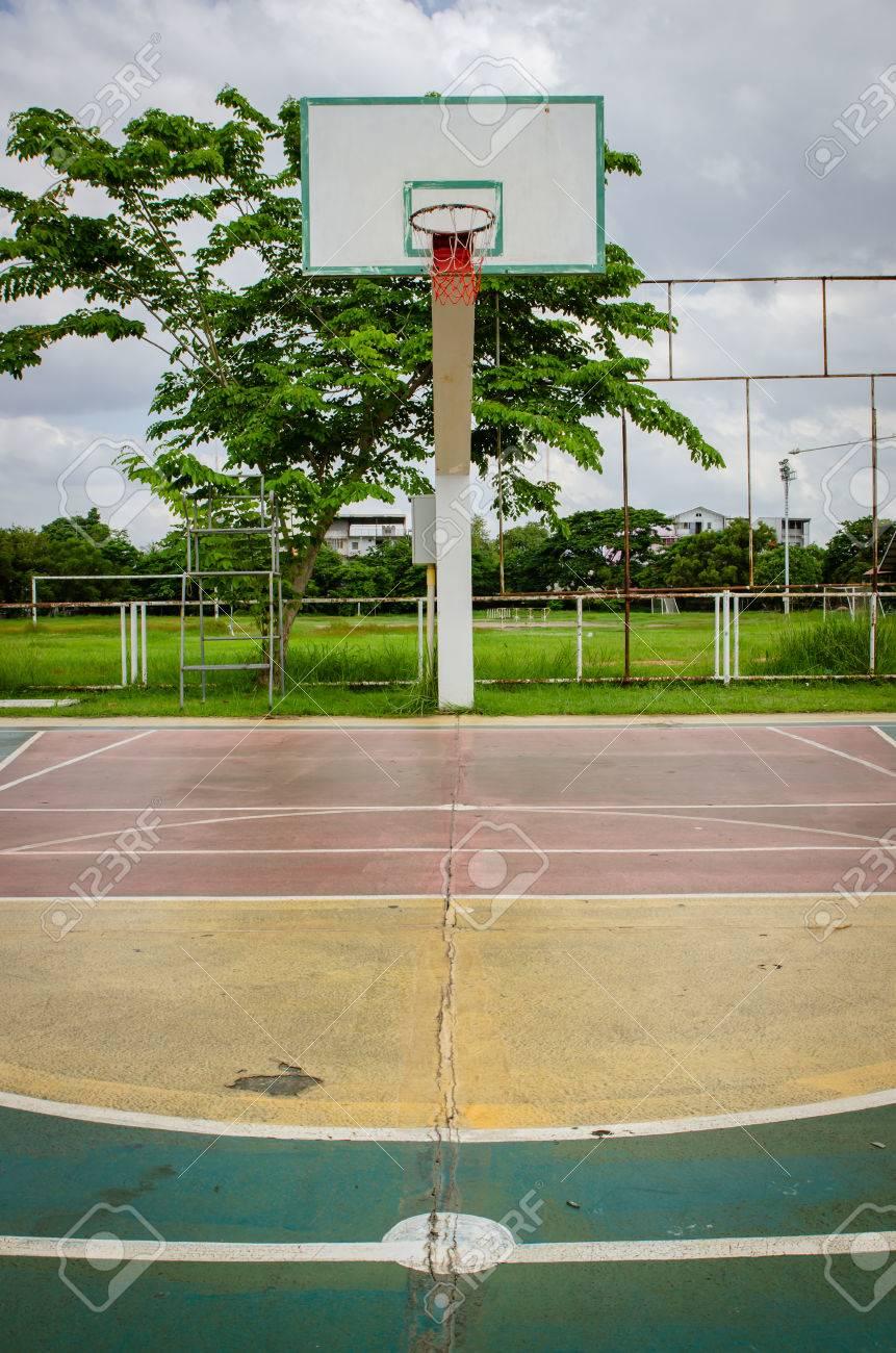 old outdoor basketball court floor stock photo