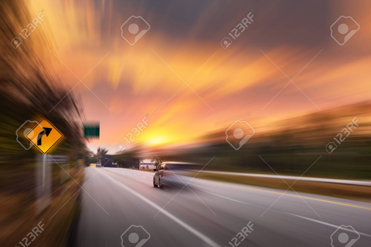 Motion Movement of Vehicle Car in Transportation Mode on Traffic Road, Motions Blur of Automotive While Speed Moving on Motorway During Sunset Scene. Transport Car Driving and Safety concept - 144470609