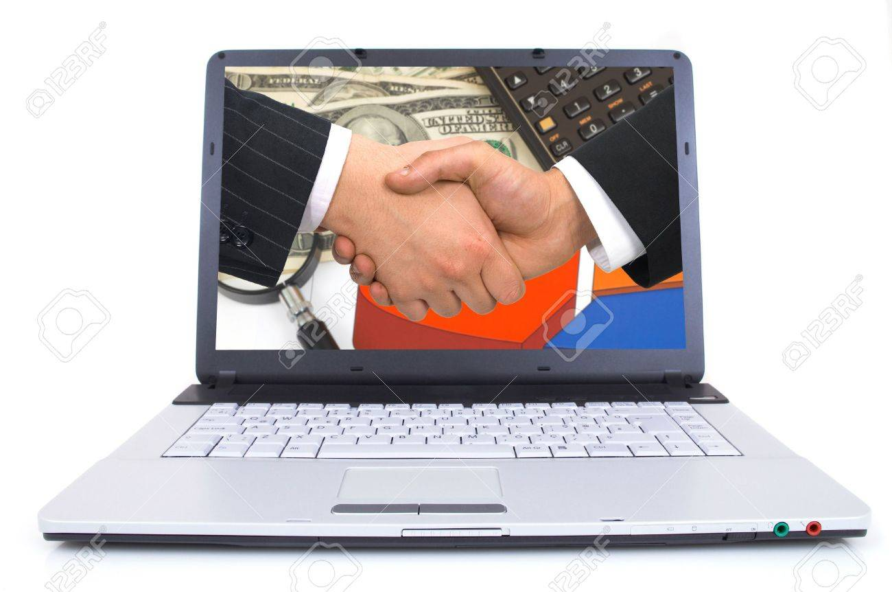 high tech laptop with handshake on screen, shot with wide angle lens, space for messages, both images are from photographers portfolio Stock Photo - 772870