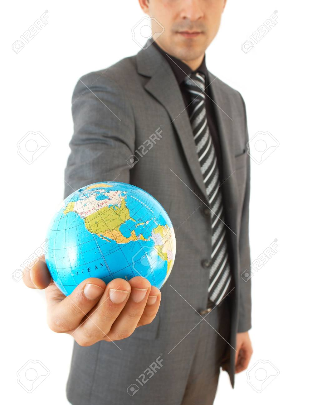 young businessman holding globe, on white background Stock Photo - 892900