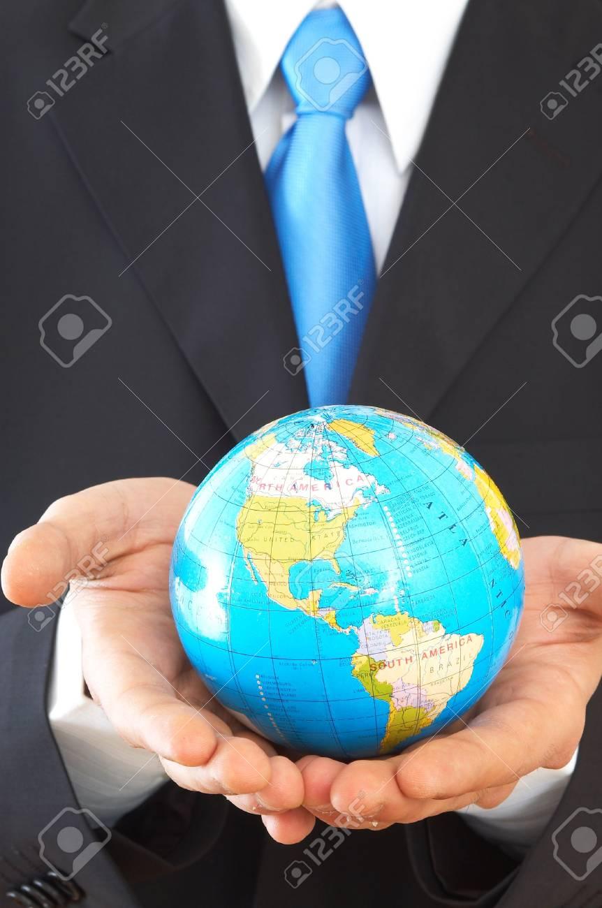businessman close up, holding mini globe, shallow dof Stock Photo - 892998