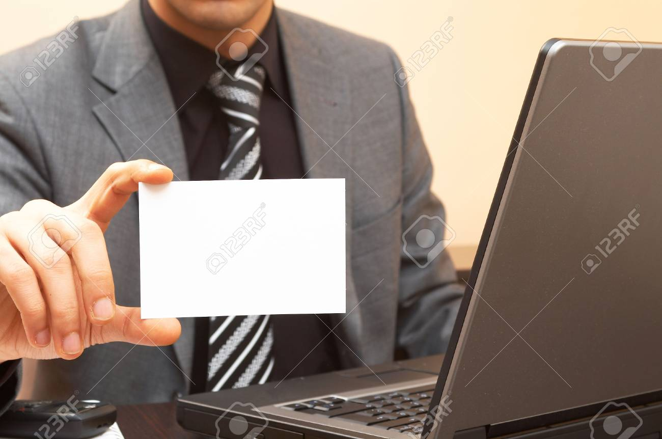 young businessman holding blank card, shallow dof Stock Photo - 901340