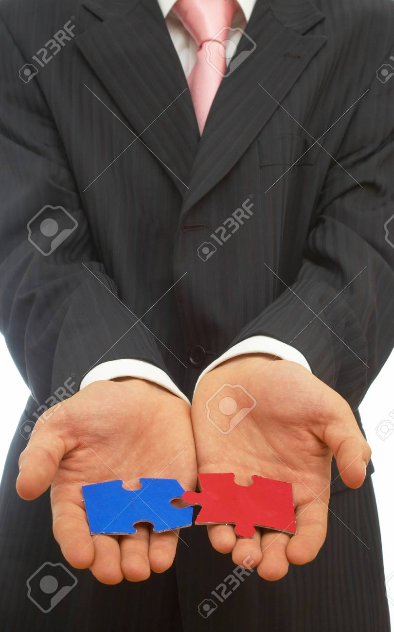 business concept with colorful puzzle pieces in hand Stock Photo - 1583497