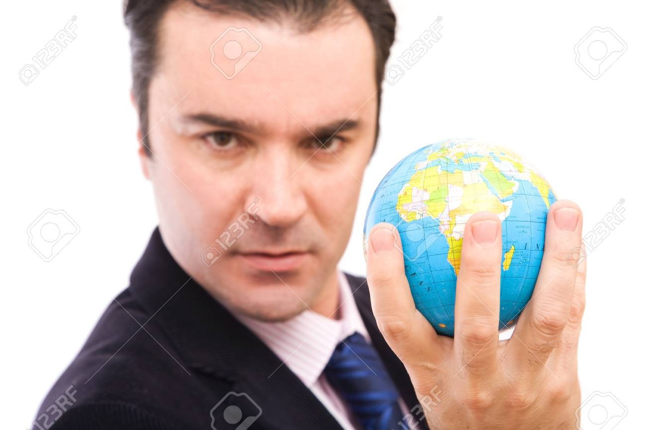Serious businessman holding mini globe on white background Stock Photo - 4293273
