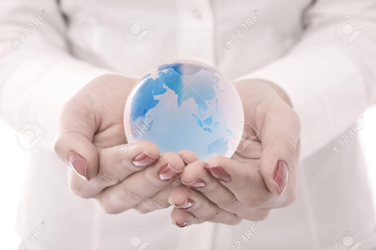 Globe on hands businesswoman hands Stock Photo - 5327515