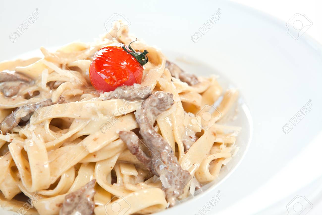 Fettuccine alfredo garnished with cherry Stock Photo - 8651215