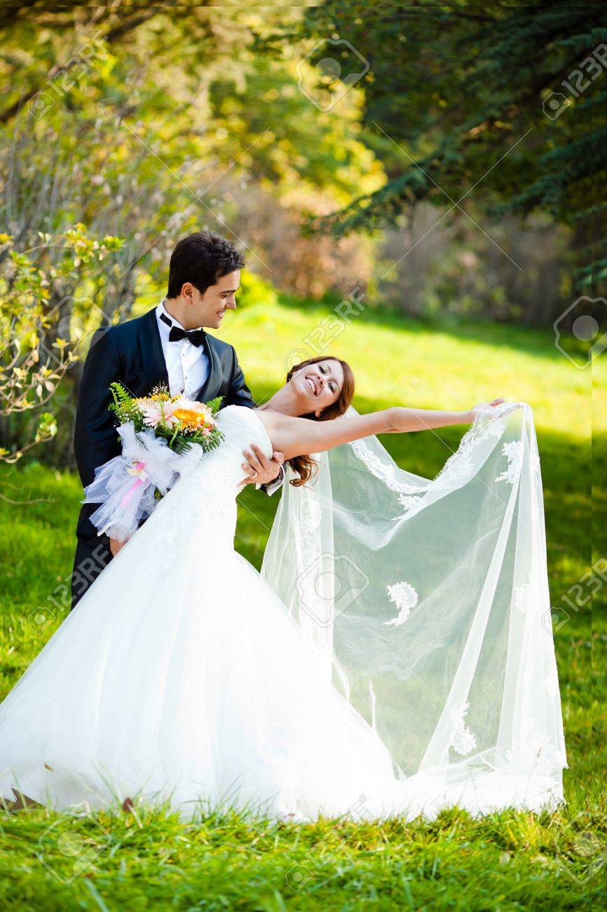 Dancing Wedding Couple At A Park On A Sunny Day Stock Photo Picture