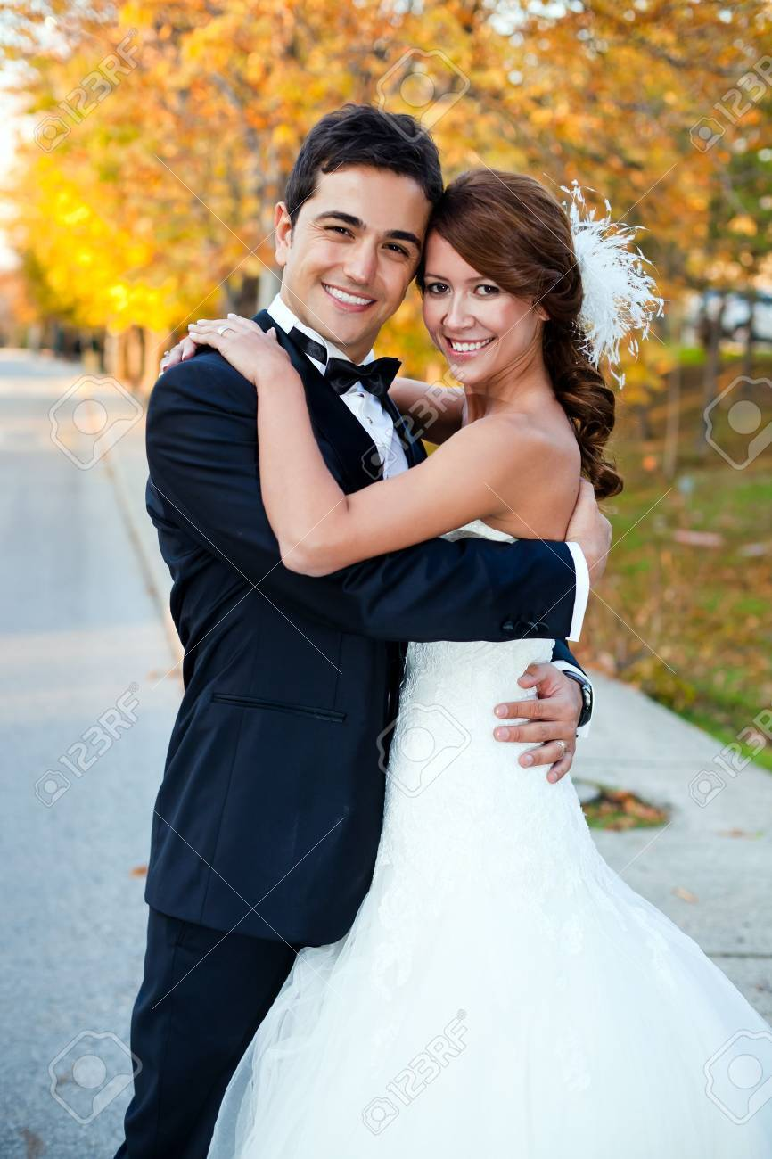 happy bride and groom at a park on their wedding day Stock Photo - 17264883
