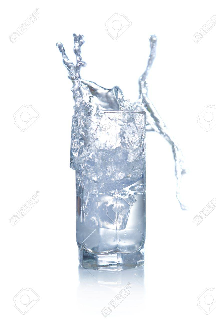 Water splashing and overflowing from glass Stock Photo - 17264915