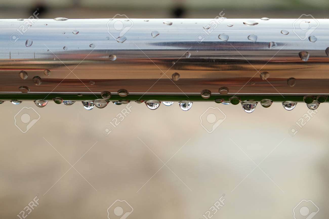 Closeup of a steel tube with dew drops Standard-Bild - 46784922