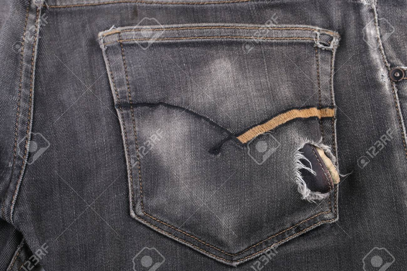 A bulky wallet on a jeans pocket, a concept of wealth Standard-Bild - 46785050
