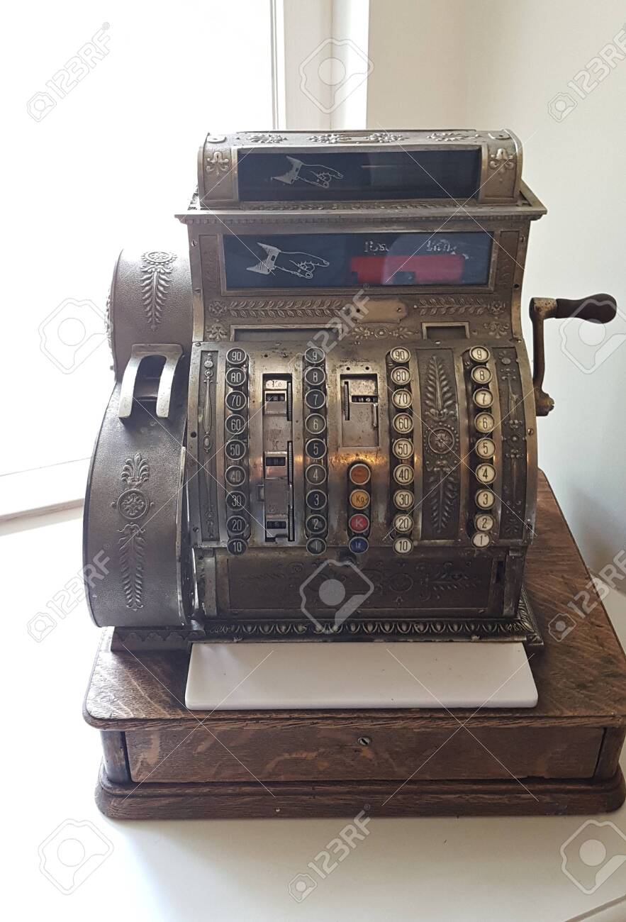 Very old antique cash register for the interior in the Malpils Manor room. Latvia, May 2019. - 136648597