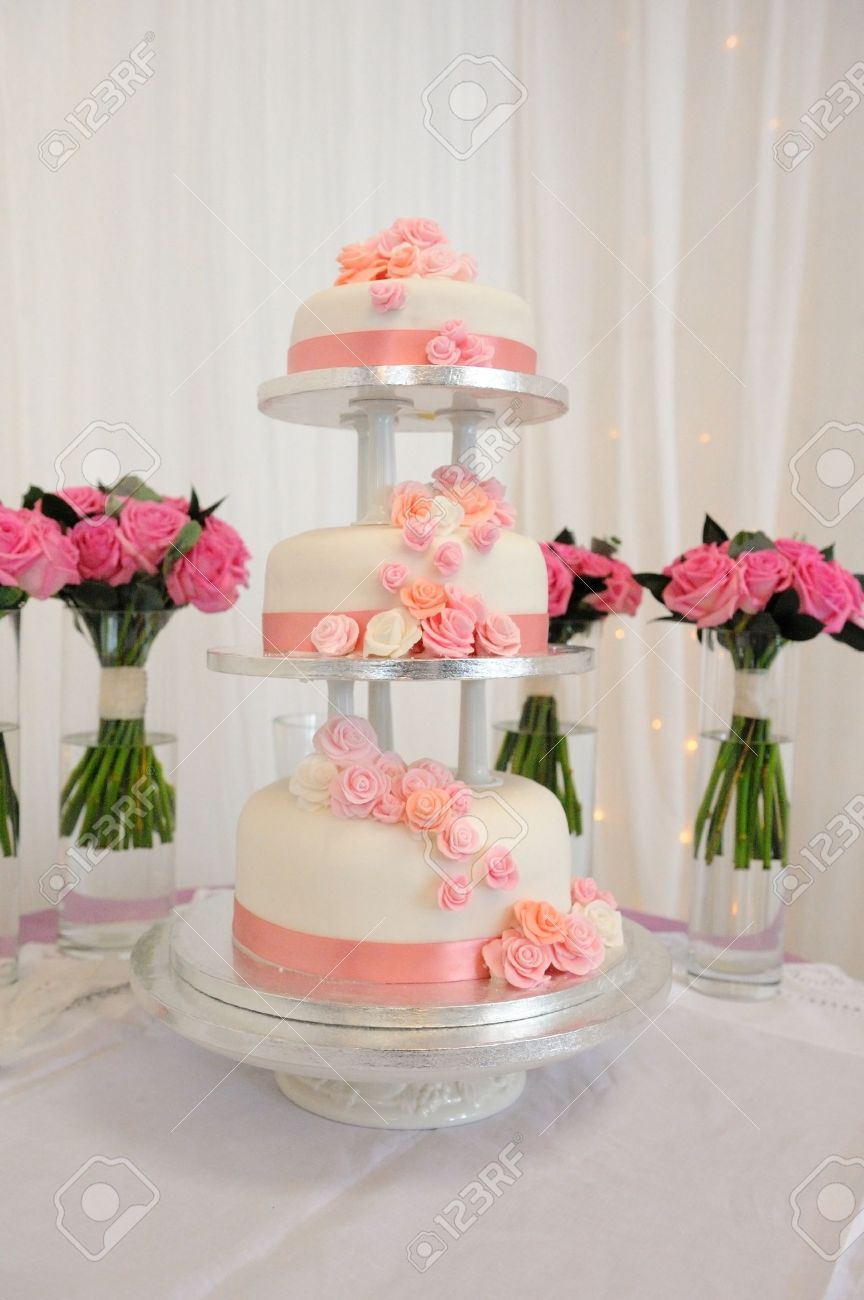Three Tear Wedding Cakes.Three Tier Wedding Cake With Peach Coloured Detail
