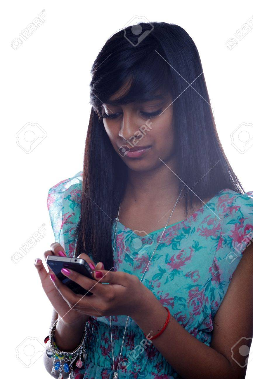 Teen girl from india with cell phone Stock Photo - 13496324