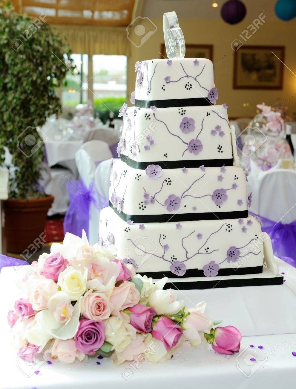 Purple Wedding Cake With Brides Bouquet At Reception Stock Photo ...