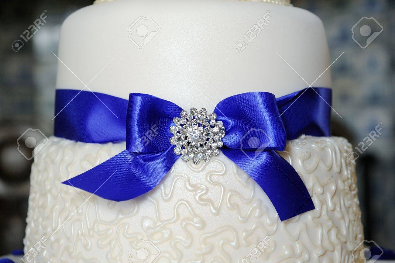 Blue Ribbon Decorates Wedding Cake At Reception Stock Photo Picture