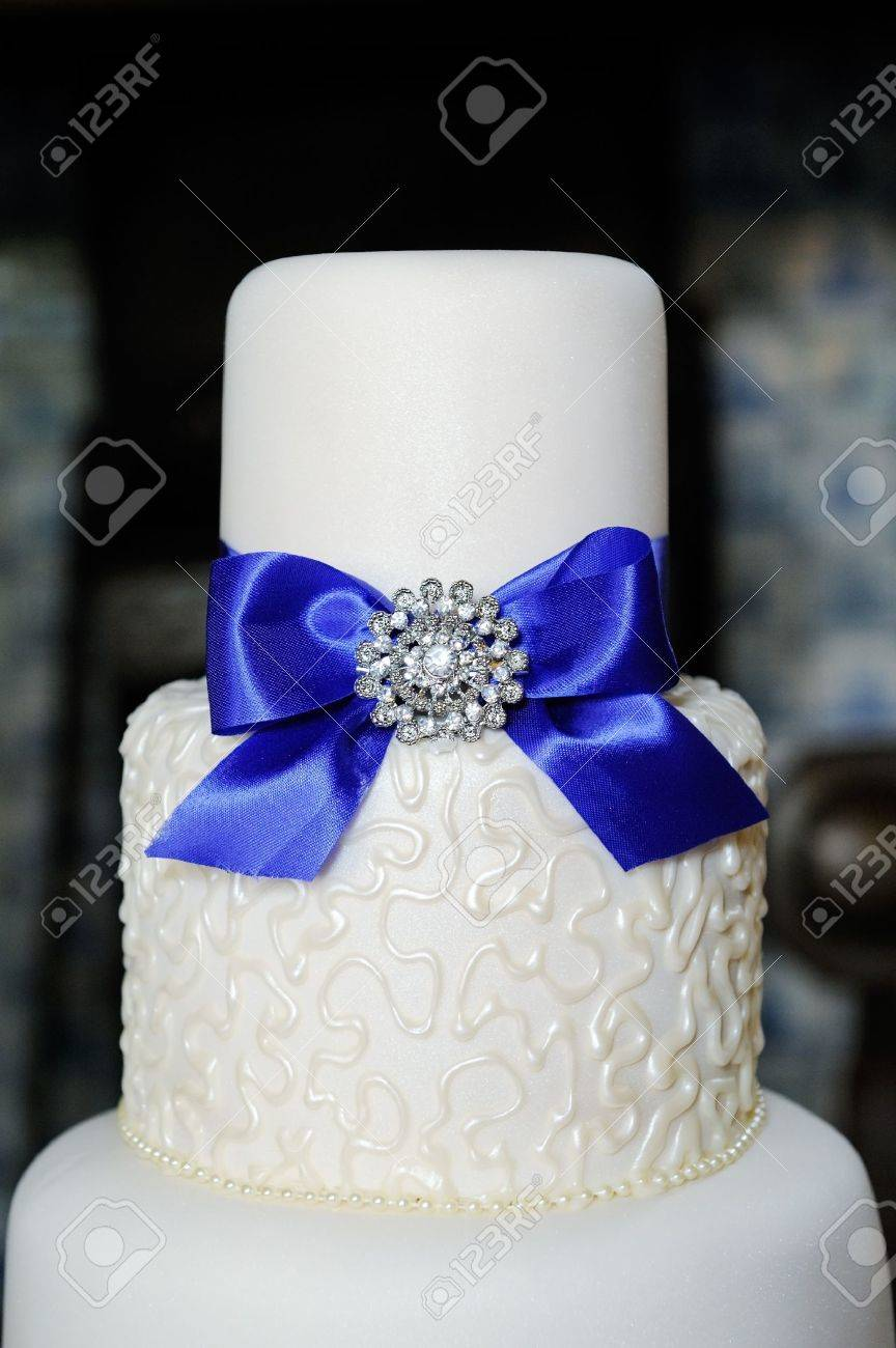 Closeup Of Blue And White Wedding Cake At Reception Stock Photo