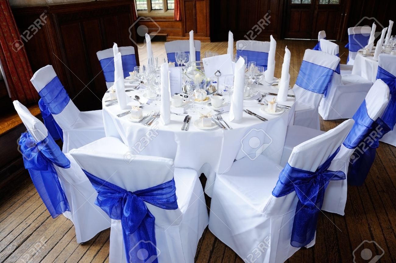 Table And Chairs Decorated In Blue And White At Wedding Reception