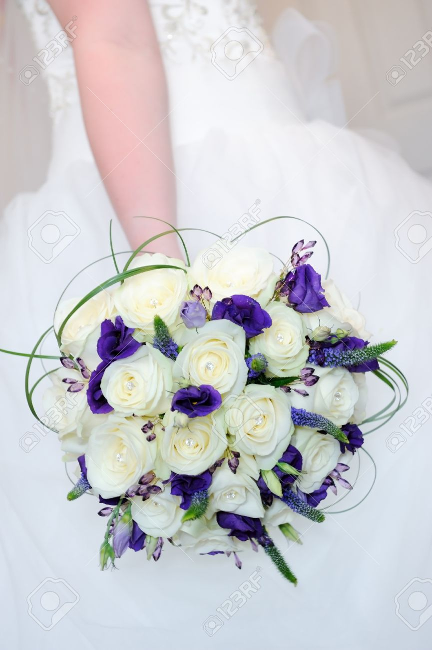 Bride Holding Bouquet Of White Rose And Purple Flowers On Wedding