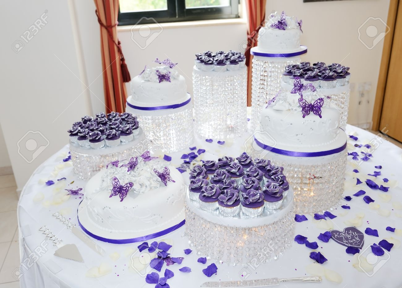 Massive White And Purple Asian Wedding Cake At Reception Stock Photo