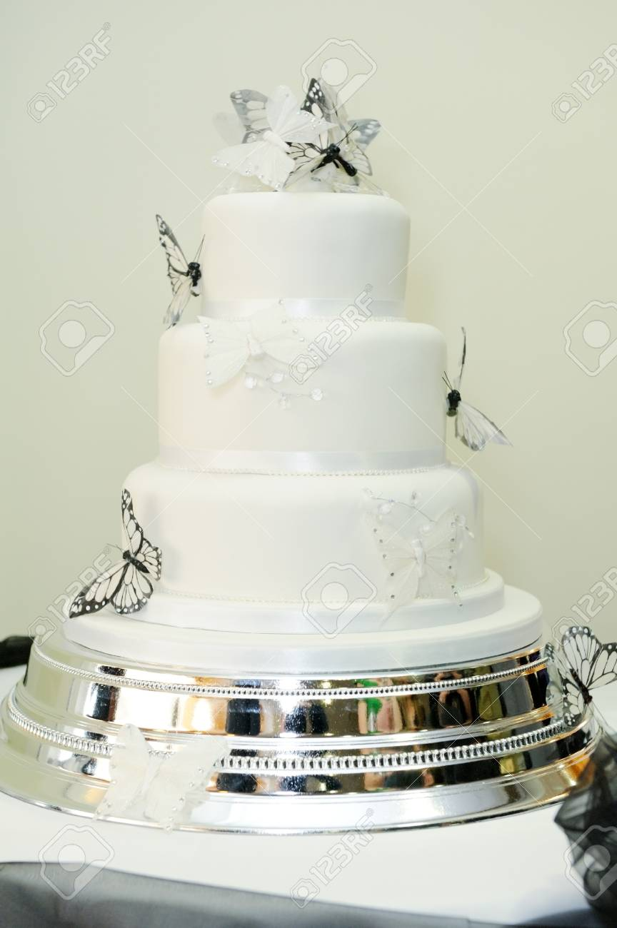 White Wedding Cake With Black Butterfly Decoration Stock Photo ...