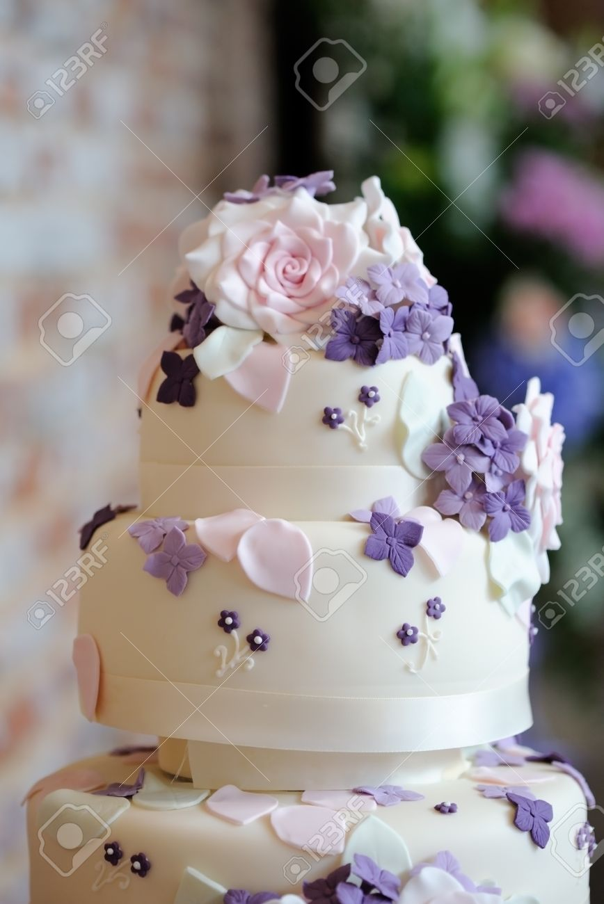 Closeup Of Wedding Cake Detail Showing Ornate Pink And Purple