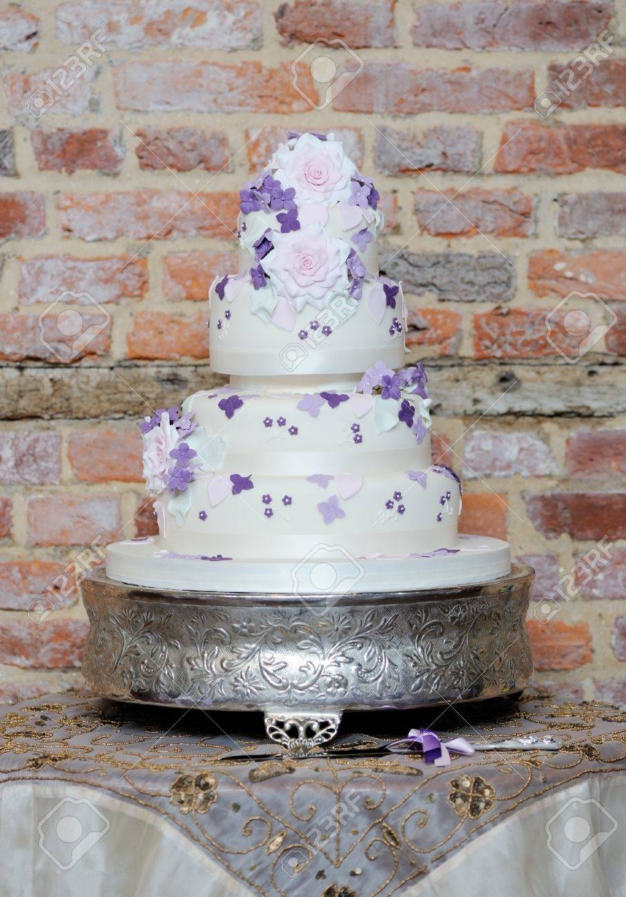Wedding Cake Showing Delicate Pink And Purple Flower Detail At