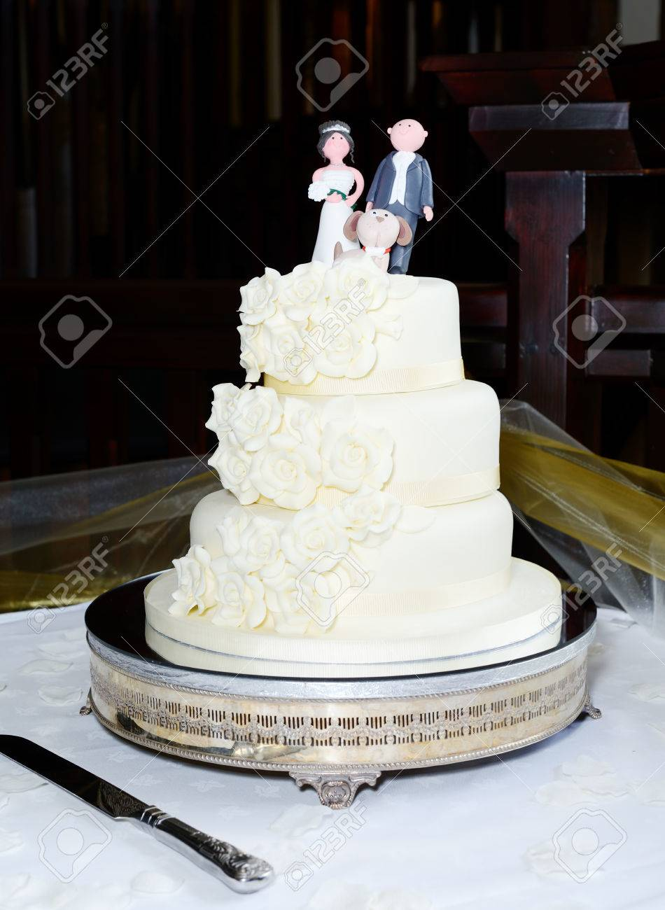Three Tear Wedding Cakes.Three Tier Wedding Cake With Bride Groom And Dog Topper At Reception