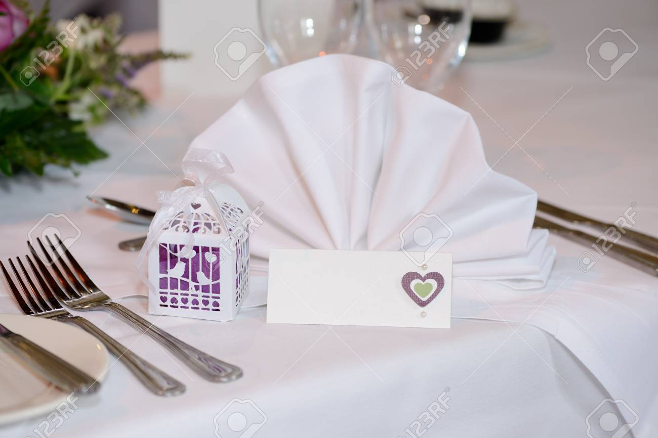 Wedding Reception Table Showing Place Setting With Napkin And ...
