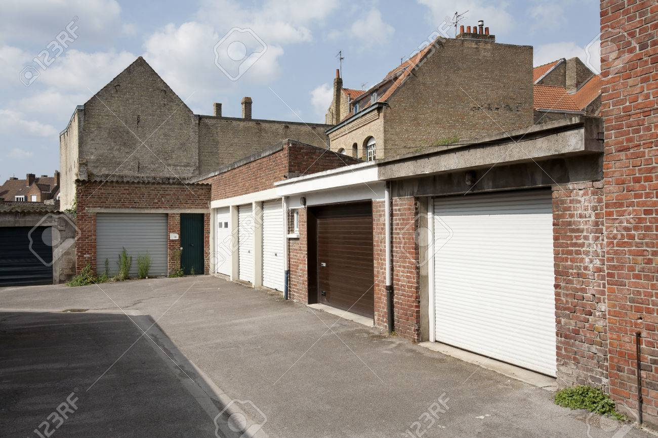 Garage Doors At The Backside Of The Houses In Bergues France Stock