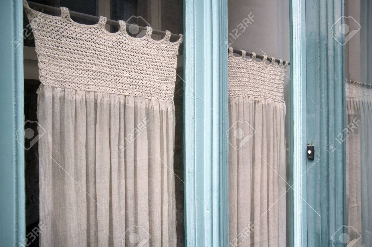 Nostalgia Glass Front Door And Partly Knitted Curtains Stock Photo    61036904