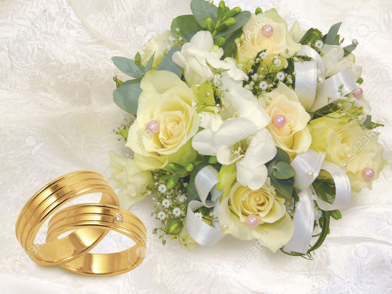 wedding gold white background stock on photo with bouquet rings