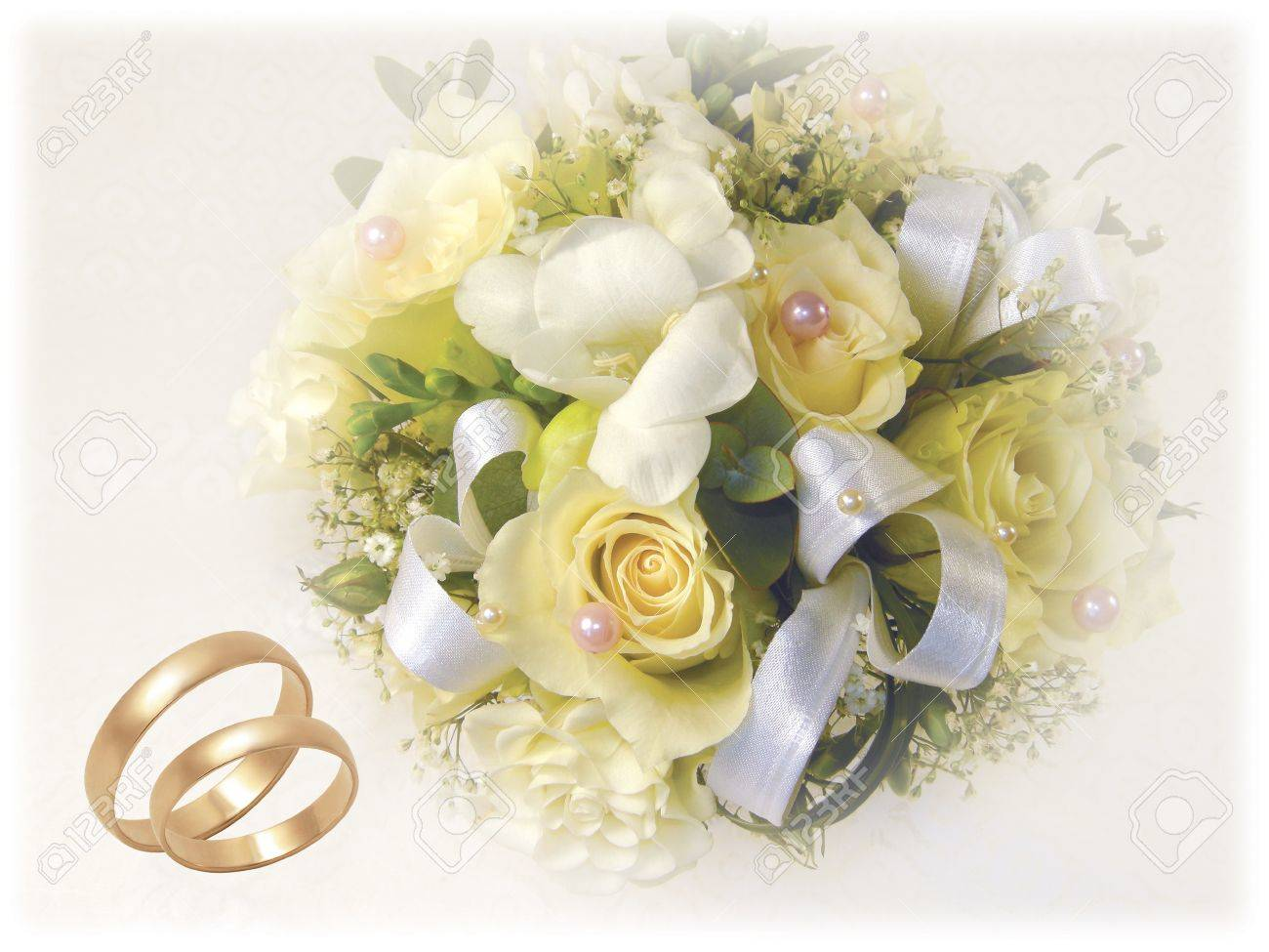 Wedding Bouquet With Gold Wedding Rings On White Background Stock