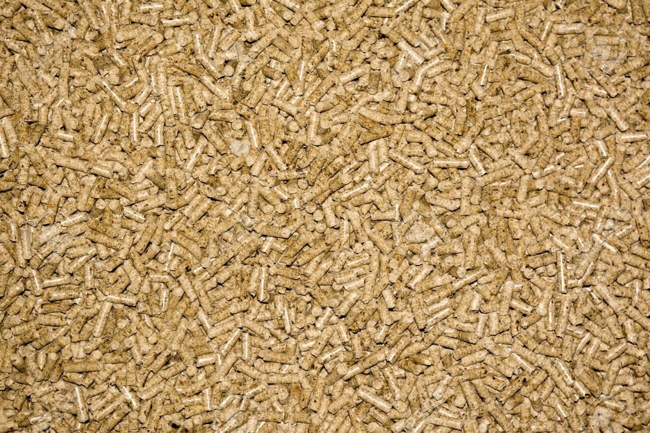 Compressed wood ecolgy pellet close up photo - 129520621