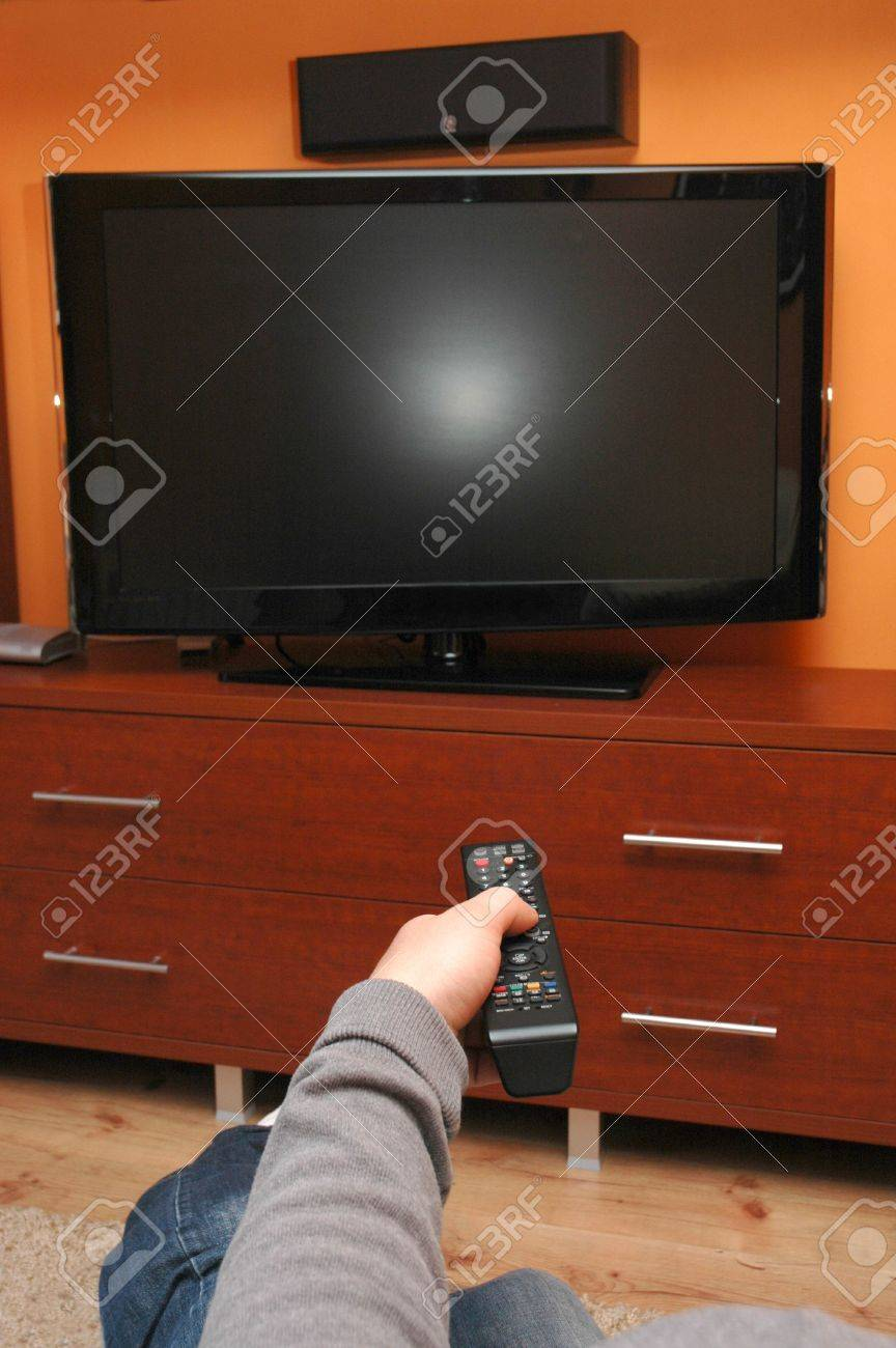 Turn on TV with remote control Stock Photo - 7910382