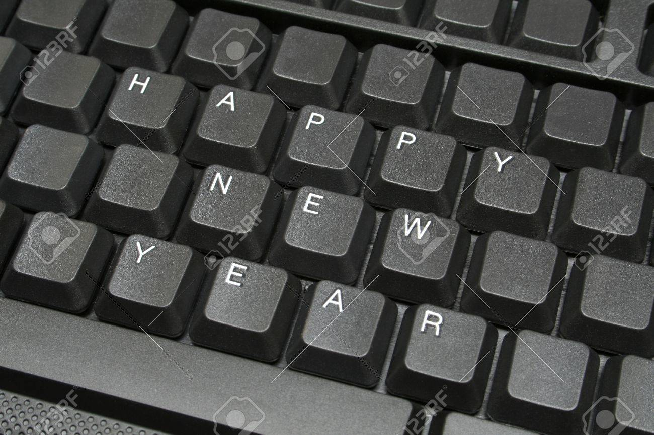 Happy new year- on computer keyboard, for people who must stay at work in that time Stock Photo - 11998935