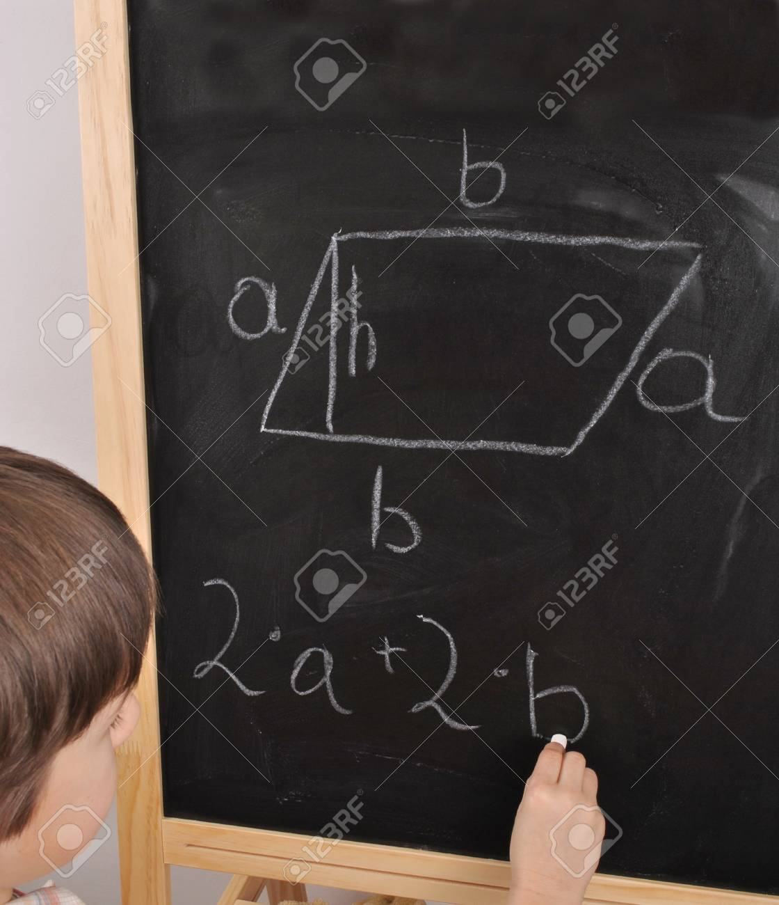 Parallelogram-student by the blackboard Stock Photo - 13485163