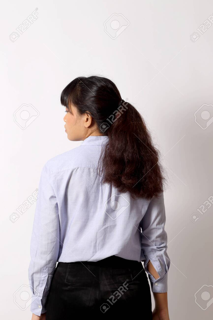 The Asian woman posing on the white background. - 128329235