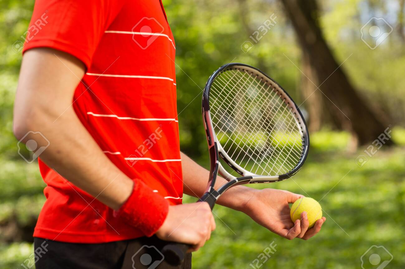 Close Up Of Men's Hands Hold A Tennis Racket And Ball On The.. Stock Photo,  Picture And Royalty Free Image. Image 143603086.