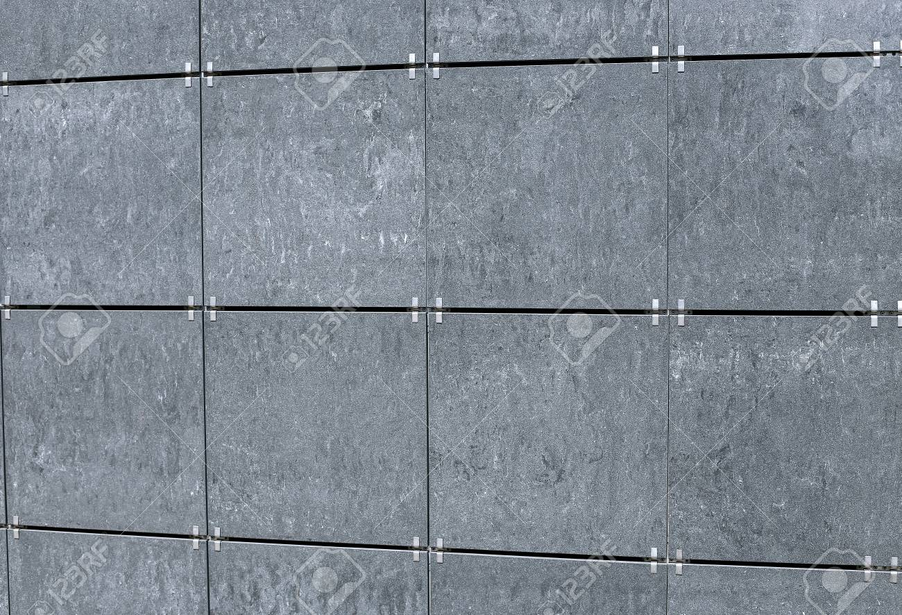 The Surface Of The Walls Decorated Facade Gray Tiles Stock Photo ...