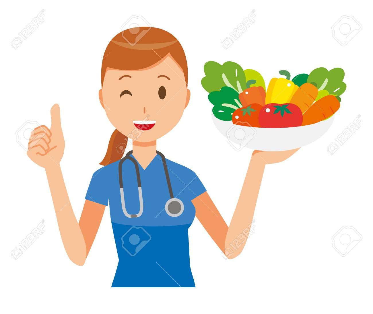A woman nurse wearing a blue scrub holding vegetables. - 91170942