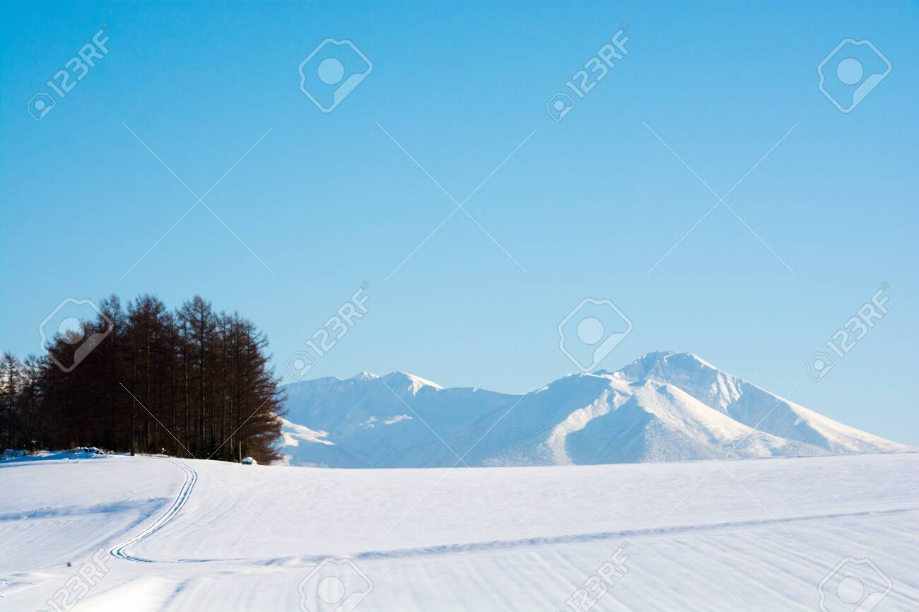 Winter blue sky and snowy mountains - 136078675