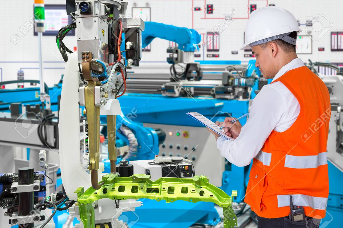 Engineer checking maintenance daily of automated automotive robotic in production line of automotive industry - 120506250