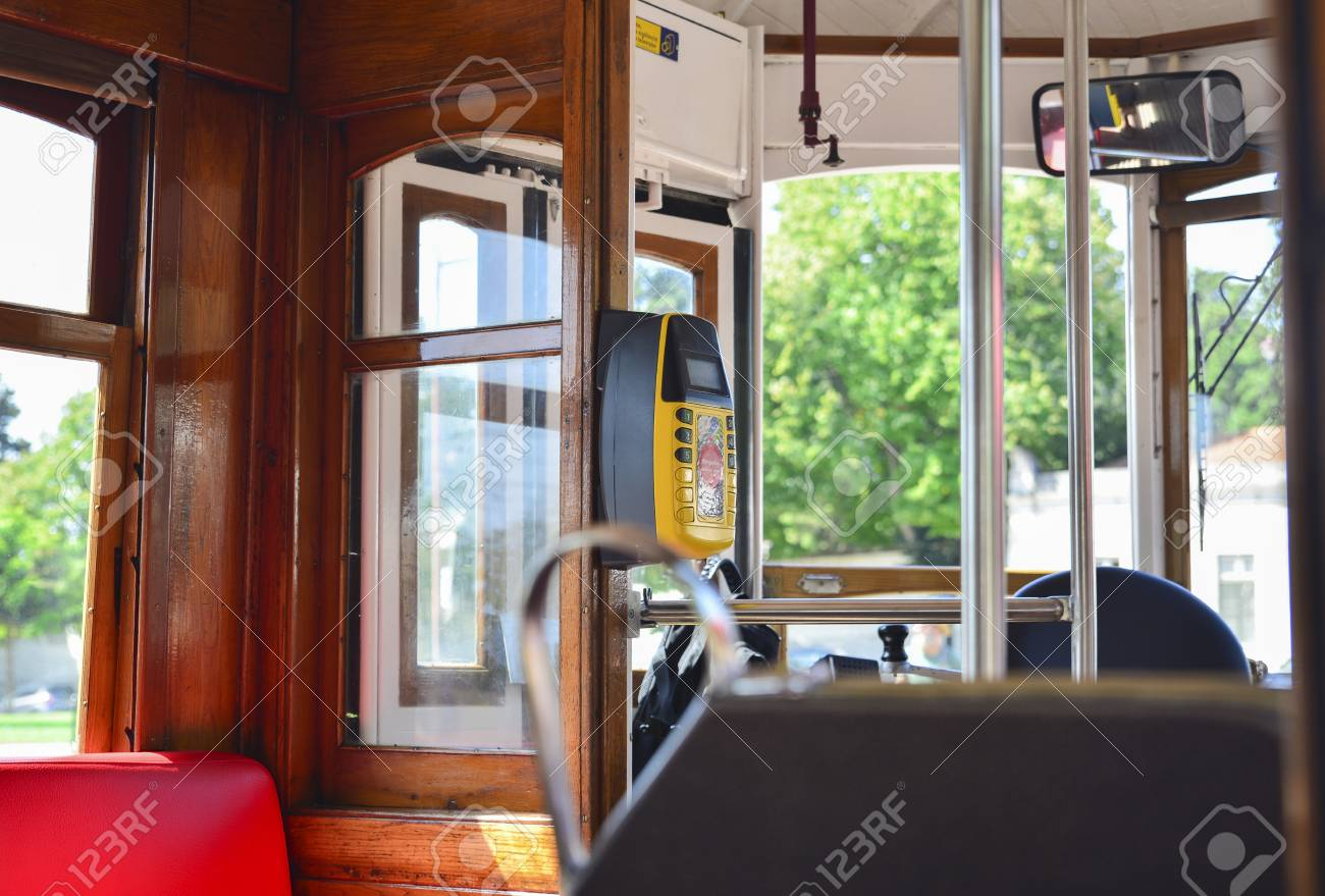 Interior of a old famous yellow elevator tram 28 in Lisbon, Portugal