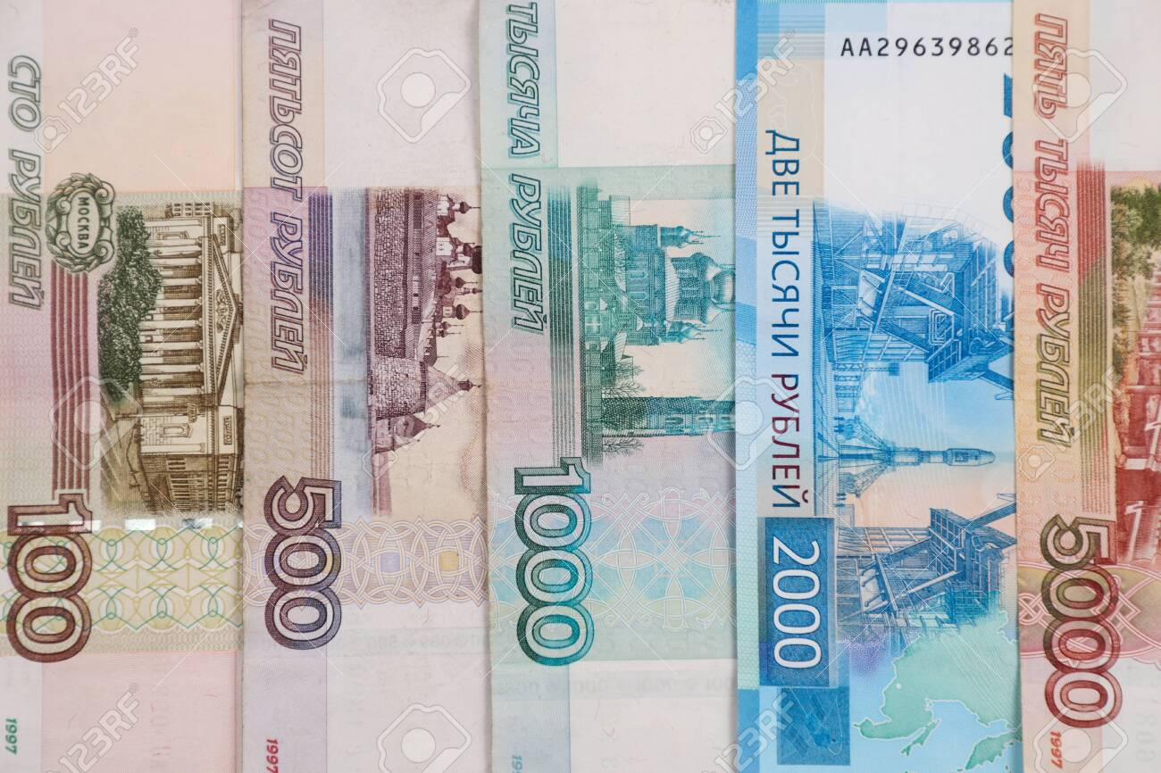 Banknotes of Russian money in denominations of 100, 500, 1000, 2000, 5000 rubles, arranged vertically. - 138237265